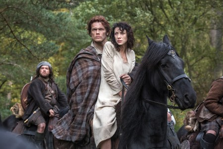 Outlander's Claire and Jamie on horseback.