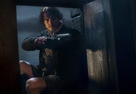 Jamie holds a gun in Outlander