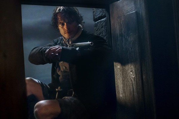 Jamie holds a gun in Outlander