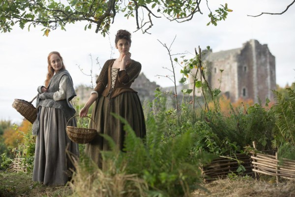 Geillis and Claire in a field on Outlander