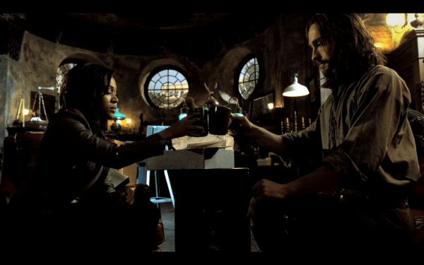 Ichabod Crane (Tom Mison) and Abbie Mills (Nicole Beharie) share a drink at the ed of S1 episode Sanctuary