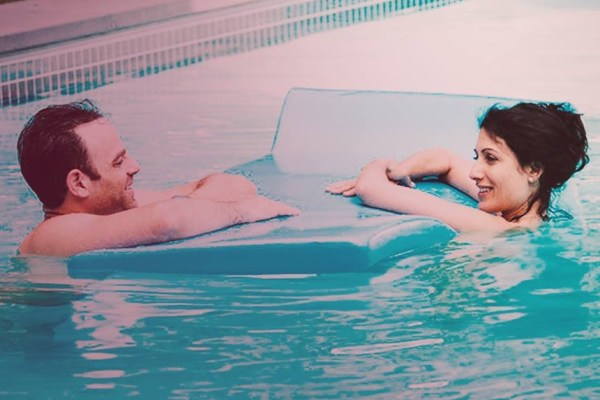 Abby and Jake in the pool on Girlfriends' Guide to Divorce