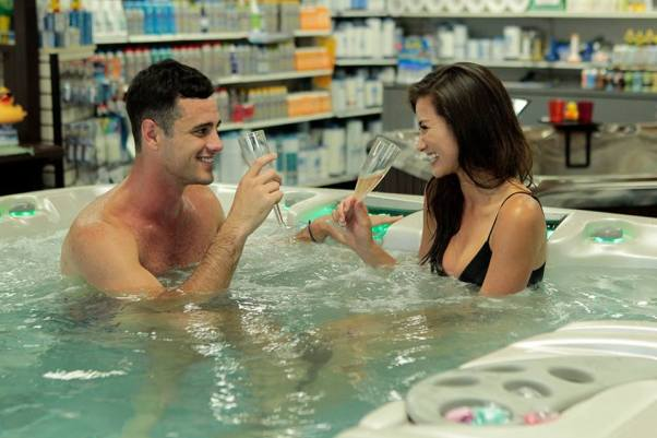 Ben and Caila in a hot tub on The Bachelor
