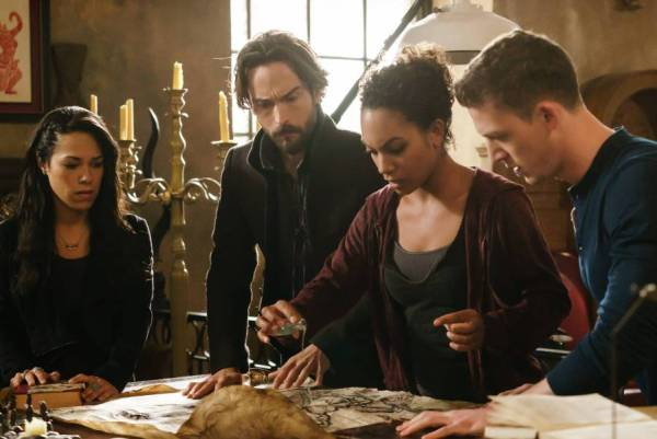 Sophie, Ichabod, Jenny and Joe work in the archives on Sleepy Hollow