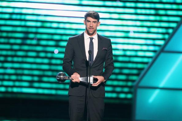 USA swimmer Michael Phelps accepts award for Best Record-Breaking Performance onstage at The 2013 ESPY Awards at Nokia Theatre L.A. Live on July 17, 2013 in Los Angeles, California. (Photo by Frederick M. Brown/Getty Images for ESPY)