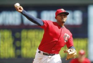Minnesota Twins infielder Eduardo Escobar throws against the Houston Astros in the ninth inning after he was called to pitch in a baseball game Thursday, Aug. 11, 2016 in Minneapolis. The Astros won 15-7. (AP Photo/Jim Mone)