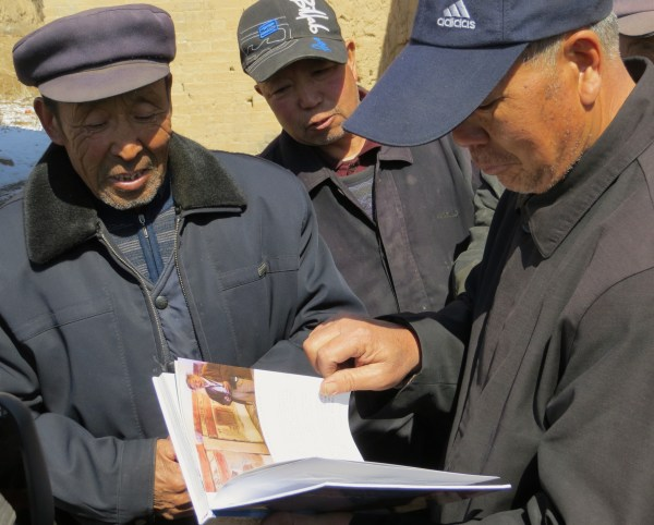 Villagers inspecting my books outside the gates of Hengjian Village, near Yu Xian