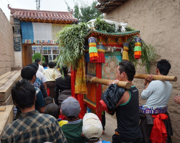 Processing the god through the streets of Nyantok Village, Rebgong, Gansu