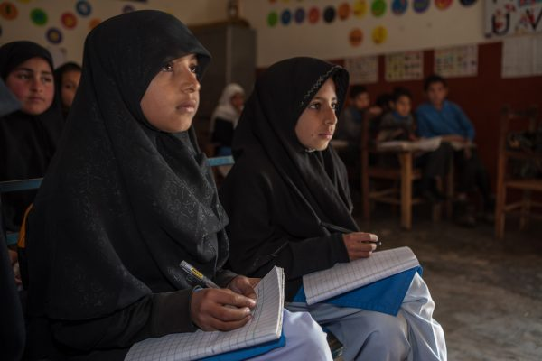 Girls from the Punjab Province in Pakistan taking notes. Photo courtesy of: Creative Commons
