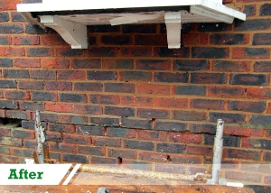 Bitumen removal from brick wall completed by UK Performance Restoration, London UK.