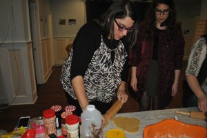 MEOR Assistant Director Devora Jaye demonstrates how to roll the dough. Jacqueline Hyman/Mitzpeh.