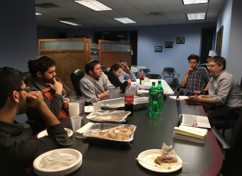 """Students listen to Rabbi Elli Fisher (right) at JLIC's first """"Food for Thought"""" of the semester Monday. Nicole Reisinger/Mitzpeh."""
