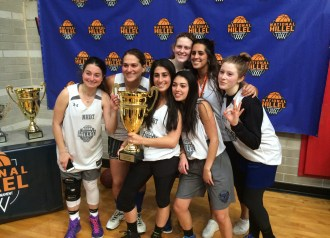 The NHBT Free Agent team, which won the women's championship 22-12 against Columbia University, celebrates with its trophy. James Whitlow/Mitzpeh.