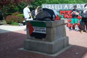 """Testudo dressed in a Palestinian flag and a sign that reads """"End Israel Apartheid"""" during the boycott. Jared Beinart/Mitzpeh."""