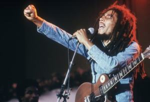 574069_Bob_MarleyJamaican_Reggae_musician_songwriter_and_singer_Bob_Marley_performs_on_stage_in_a_co