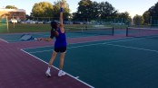 Erin Ryder practices her serve before her tennis match