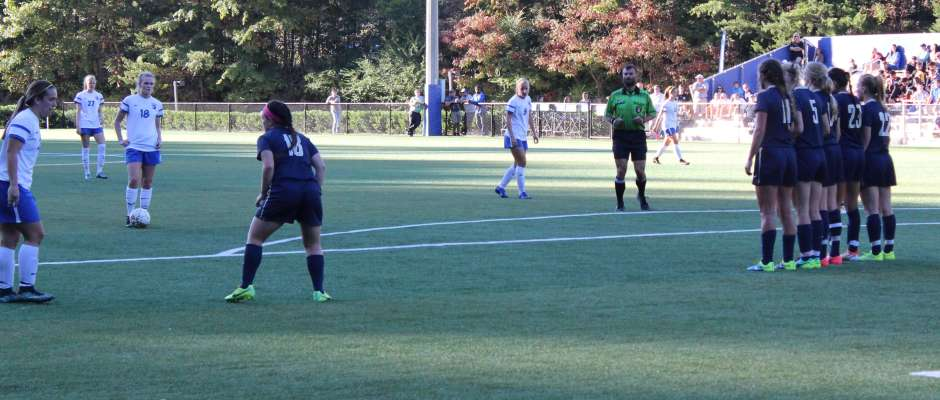 North Georgia's Sophia Matonak eyes a wall of Wingate defenders before sending the free kick past the wall and the keeper for the goal. The goal was Matonak's third of the season and gave the Nighthawks a 2-1 lead. (Photo by Jake Cantrell)