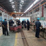 Workers at one of the railway workshops in Yangon.