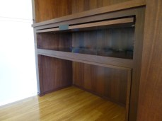 Mahogany niche inset cabinets with LED illumination
