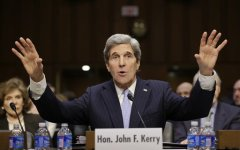 Senate Foreign Relations Chairman Sen. John Kerry, D-Mass., sits before the committee he has served on for 28 years as he seeks confirmation as U.S. secretary of state on Capitol Hill in Washington. Kerry was the target of ridicule as a woman from the audience began yelling objections during his testimony. (AP Photo)