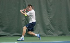 BYU tennis player Francis Sargeant returns the ball during Saturday's match against Utah State at the Indoor Tennis Courts. Photo courtesy BYU Athletics.
