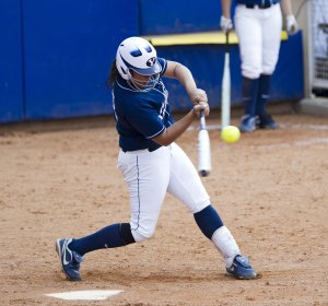 Katie Manuma hits the ball during a home game. (Photo courtesy BYU Athletics)