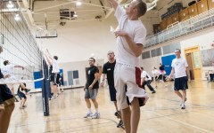 Student Tyler Fougler hits the ball during intermediate volleyball class in the Richards Building. (Photo by Chris Bunker)