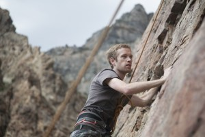 Mike McKell climbs a rock face at Rock Canyon. (Photo by Elliott Miller)