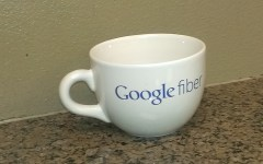 Charles Robinson, Alpine Village leasing consultant, owns a Google Fiber cup. Alpine Village will be the first Provo apartment complex to get Google Fiber before the end of October or the beginning of November. (Photo by Jordan Miera.)