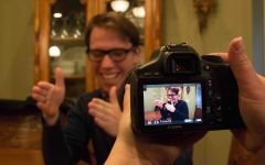 Stephen Nelson meets with his dating coach and has her film a bit of the session. Photo by Ari Davis.