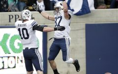 BYU wide receiver Mitchell Juergens, right, celebrates his touchdown catch with teammate Mitch Mathews during the first half of an NCAA college football game against California, Saturday, Nov. 29, 2014, in Berkeley, Calif. (AP Photo/Marcio Jose Sanchez)