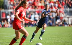 Ashley Hatch races to block the ball from a University of Utah on September 5, 2014 (Universe Photo.)