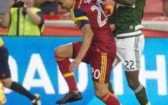 Real Salt Lake's Luis Silva (20) tries to get past Portland Timbers' Rodney Wallace (22) during an MLS soccer match Saturday, Aug. 15, 2015, in Sandy, Utah. (Rick Egan/The Salt Lake Tribune via AP)