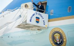 President Barack Obama waves as arrives on Air Force One at Des Moines International Airport in Des Moines, Iowa, Monday, Sept. 14, 2015. Obama is expected to officially announce a change to the college financial aid system. (Associated Press)