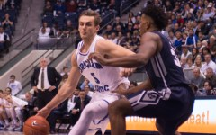 Kyle Collinsworth drives to the hoop against Utah State. Collinsworth continues to lead the Cougars on and off the court. (Natalie Bothwell)
