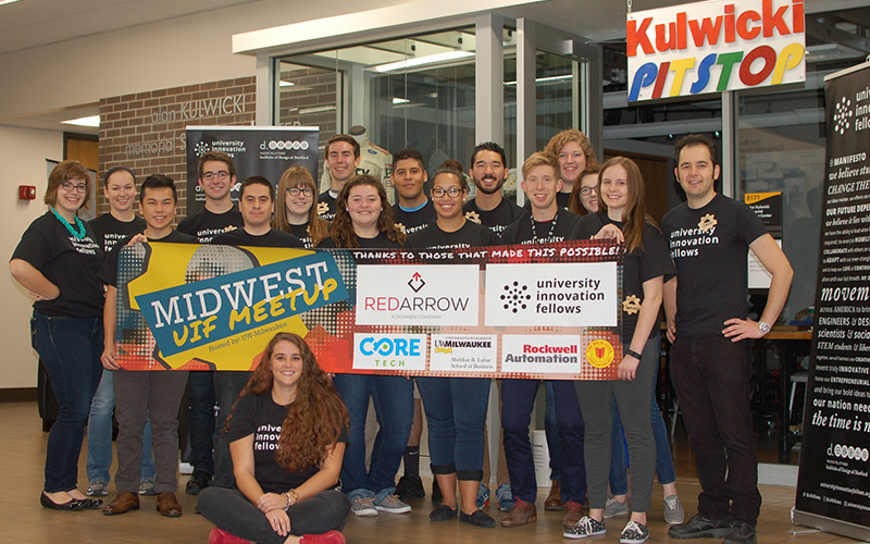 University Innovation Fellows in front of the Kulwicki Pitstop. From left: Nicole Green, Kathryn Christopher, Jim Lee, Brd Turner, David Gallegos, Elizabeth Creamer, Andrew Schilling, Megann Dykema, Eduardo De Leon, Alycia Doxon, Jonathan Cook, Alex Francis, Hannah Barton, Lydia Gregersen, Samantha Schultz, Amin Mojtahedi and Katie Dzugan (sitting)