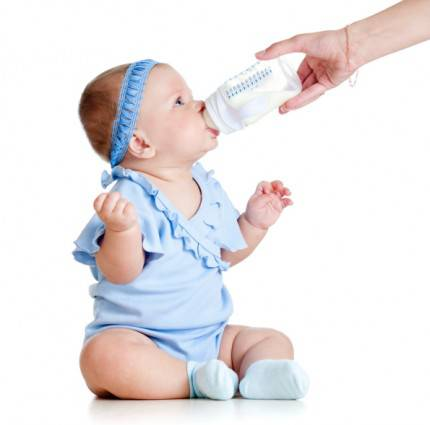 latte vaccino - adorable baby girl drinking from bottle with help of mother
