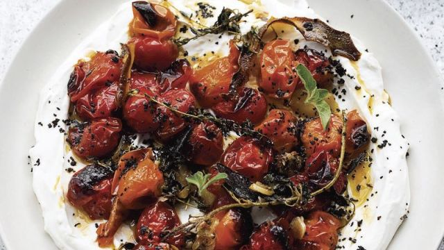 Hot, charred cherry tomatoes with cold yogurt from the book Ottolenghi Simple A Cookbook by Yotam Ottolenghi