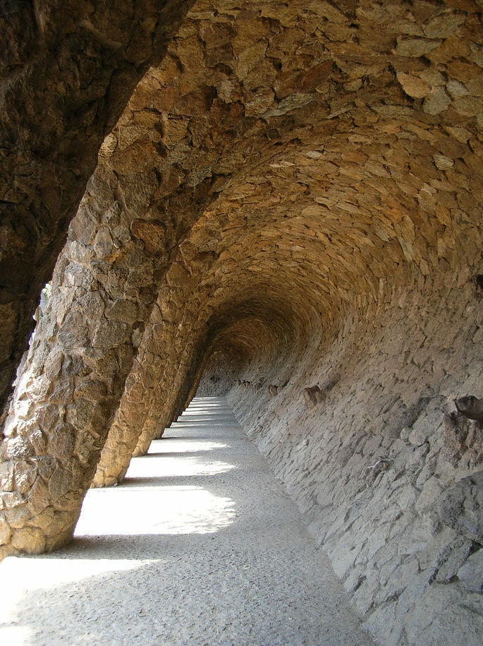 Colonnaded pathway where the road projects out from the hillside, with the vaulting forming a retaining wall which curves over to support the road, and transmits the load onto sloping columns.
