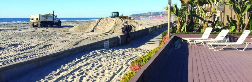 El Niño winds blow sand across the barrier at Mission Beach.