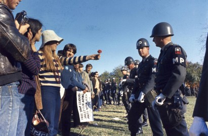 A demonstrator offers a flower to military police at an anti-Vietnam War protest at The Pentagon in Arlington, Virginia, 21 October 1967