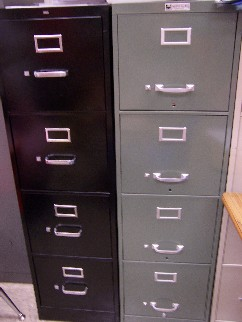 Two tall metal file cabinets for work or home use
