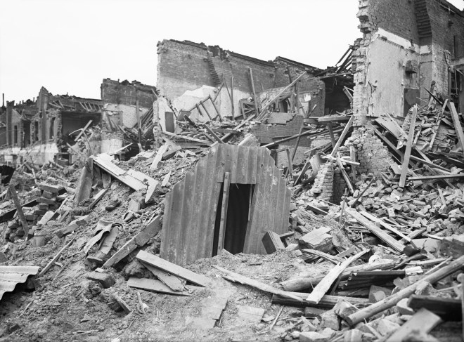File:An Anderson shelter remains intact amidst destruction in Latham Street, Poplar, London during 1941. D5949.jpg