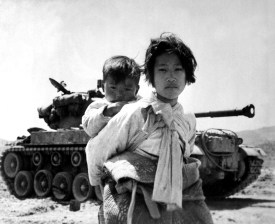Sibling refugees during the 1950-53 war, the last time North Korea shelled innocent civilians until last months attack on a Southern Island. Photo: 1951, Major F.V. Spencer, UAF