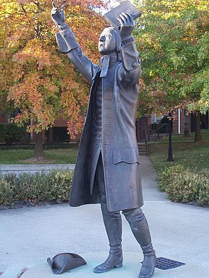 Life-size statue of John Wesley on the campus ...