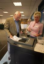 Vice President Dick Cheney casts his ballot in...
