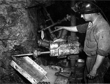 Hard rock mining at the Associated Gold Mine, ...