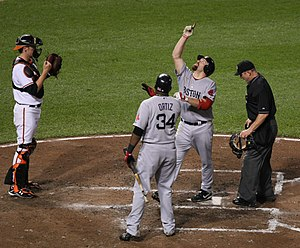 English: Kevin Youkilis pointing skyward.