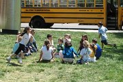 Children playing &quot;Duck Duck Goose&quot;, ...