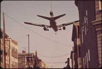 NEAR LOGAN AIRPORT-AIRPLANE COMING IN FOR A LA...